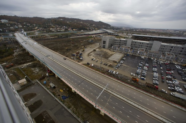 In this photo taken on Wednesday, Nov. 27, 2013, a new highway is seen on the fringes of the Olympic park in Sochi, Russia. As the Winter Games are getting closer, many Sochi residents are complaining that their living conditions only got worse and that authorities are deaf to their grievances. (AP Photo/Alexander Zemlianichenko)