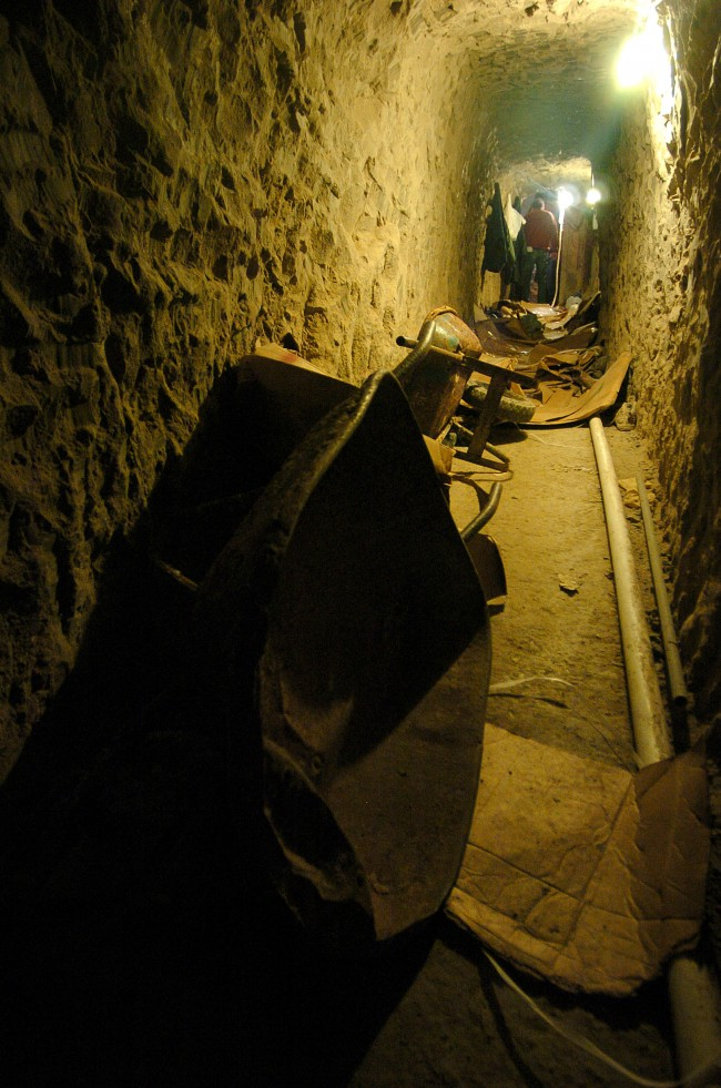 Wheelbarrows sit on the ground of a sophisticated clandestine tunnel that passes under the US-Mexico border on Wednesday, Jan. 25, 2006 in Tijuana, Mexico. The tunnel, which is about 2,400 feet long and around 60 feet underground, is accessed through a large concrete block shaft in a warehouse south of the border wall. (AP Photo/David Maung)