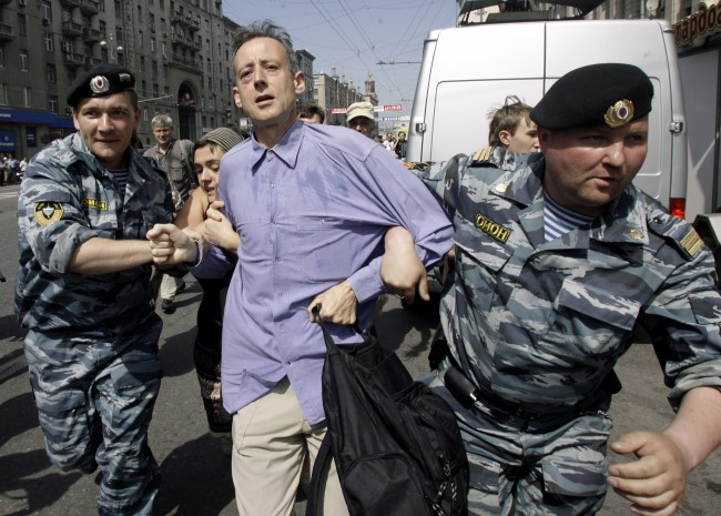 Russian OMON riot police officers detain British human rights activist Peter Tatchell as gay rights activists try to hold a demonstration in downtown Moscow Sunday, May 27, 2007. Russian police detained gay rights activists, including at least two European lawmakers, as they tried to hold a demonstration in downtown Moscow on Sunday while conservatives punched the activists and pelted them with eggs. The demonstrators, appearing to number less than 100, tried to present a letter signed by some 40 European lawmakers to the office of Moscow's mayor, appealing the city's ban on a march they wanted to conduct. (AP Photo/Sergey Ponomarev)