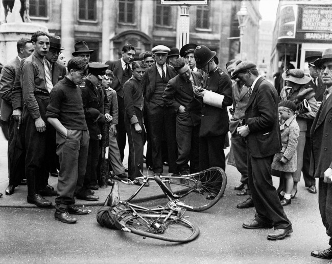 A wrecked bicycle after a crash involving a bus. Date: 04/09/1936