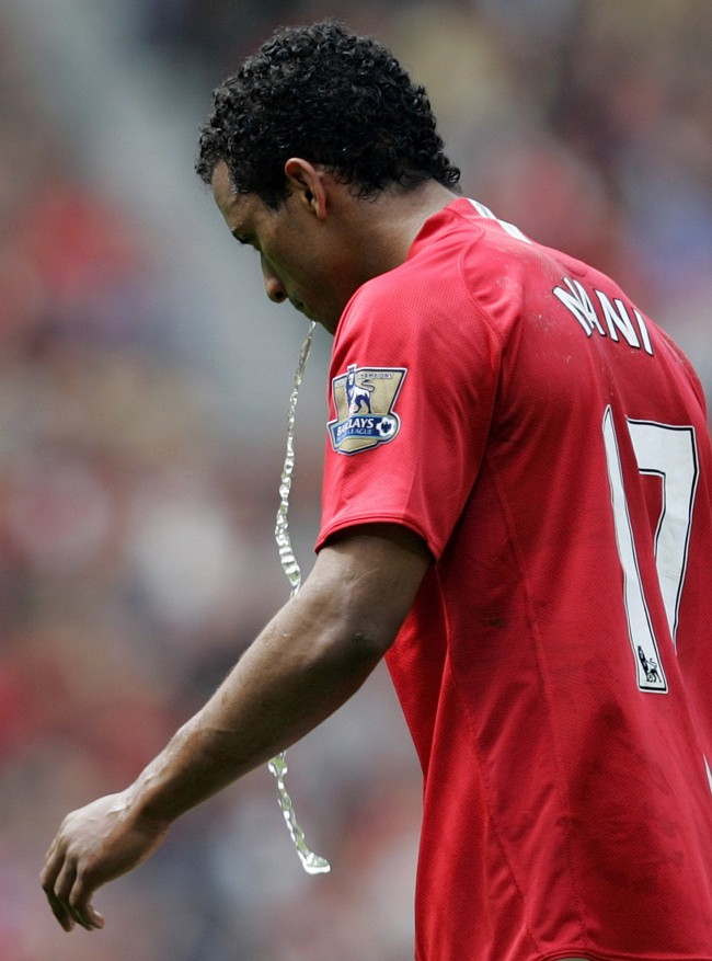 Manchester United's Nani reacts by spitting water after being sent off