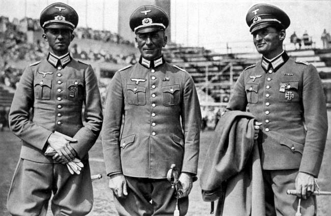 (L-R) The Germany team who won gold in the dressage section: First Lieutenant Heinz Pollay, Major Friedrich Gerhard, Herrmann von Oppeln-Bronikowski NULL