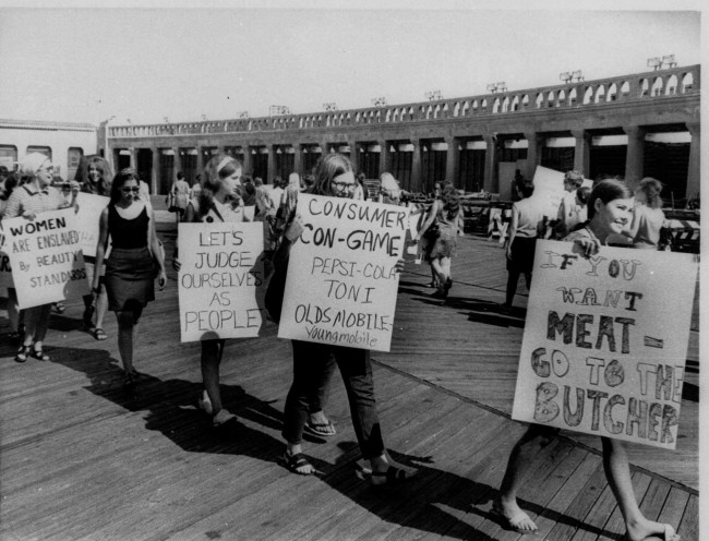 "Pickets from a group calling itself ""Women's Liberation Party"" march in front of the Convention Hall in Atlantic City, N.J. in protest of the annual staging of the Miss America Pageant, Sept. 7, 1968. (AP PHOTO)"