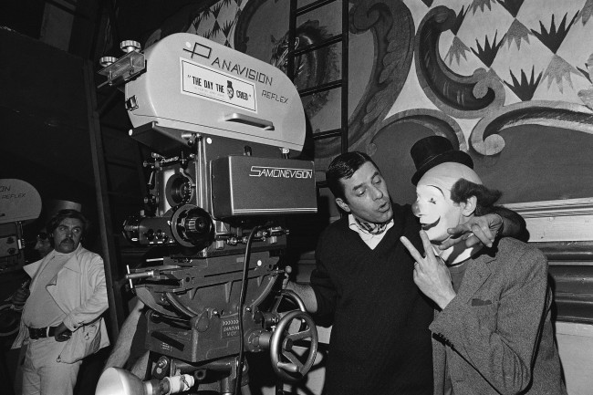 Jerry Lewis, center, shot first sequence of his film The Day the Clown cried and seen here left with French actor Pierre Etaiy, right, March 20, 1972, Paris, France.