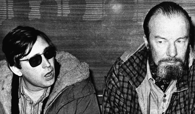"Barcelona University students battled police with stones today after a concert by American Folksinger Pete Seeger was banned unexpectedly. Picture shows Seeger (right), with Catalan folksinger ""Raimon"" during a news conference in Madrid on Wednesday, Feb. 13, 1971. (AP Photo/L. Gomez)"