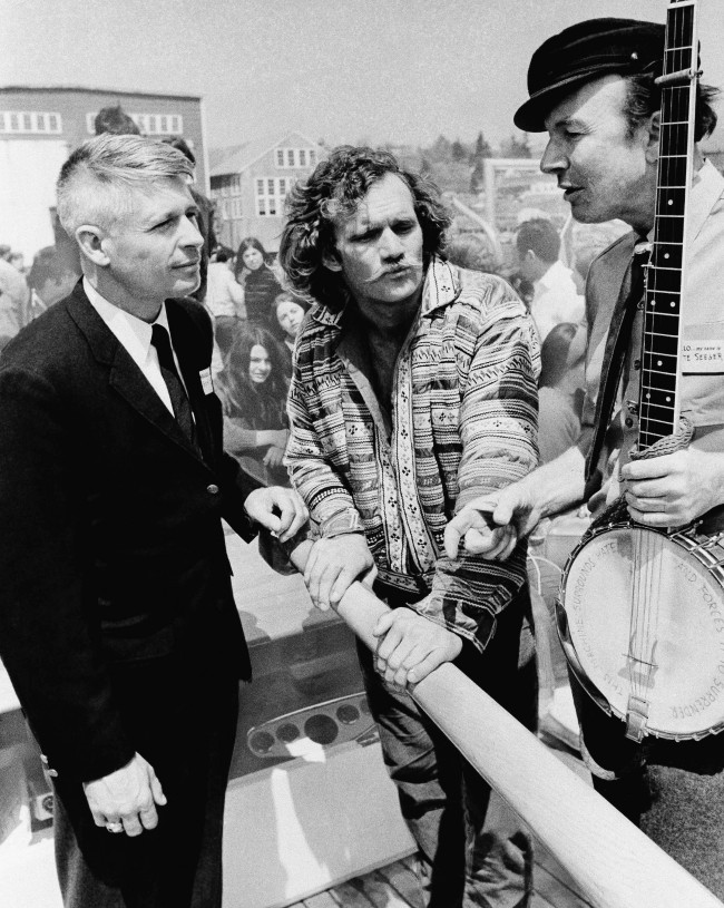 Gov. Kenneth Curtis of Maine, left, skipper Alan Aunapu (center), and folk singer Pete Seeger at launching ceremonies for the sloop Clearwater at South Bristol, Maine in May 1969. (AP Photo)