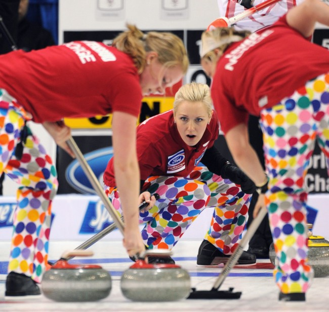 This photo made March 21, 2010, shows Norway's skip Linn Githmark, center, during an evening draw against Canada in Swift Current, Sask. There was a large package waiting for Norway when the team arrived in Swift Current, Sask., for the women's world curling championship. Out of the box came even louder versions of the loud pants their male counterparts popularized at the Winter Olympics in Vancouver last month.(AP Photo/The Canadian Press/HO, Michael Burns)