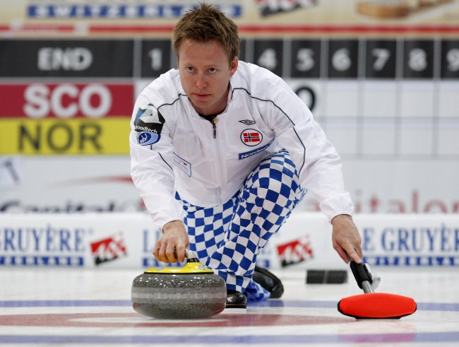Norway's skip Torger Nergard releases a stone on his way to win a semifinal match against Scotland, at the Curling World Championships, in Cortina D'Ampezzo, Italy, Saturday, April 10, 2010. (AP Photo/Antonio Calanni)