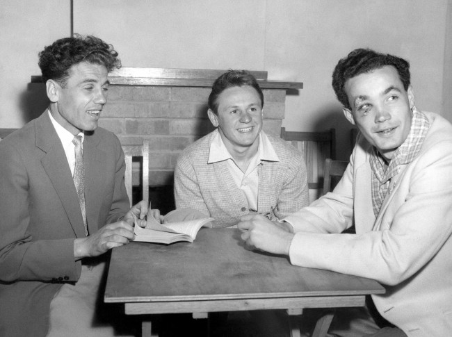 Hungarian athletes, who have indicated that they will not be returning to their homeland, talk over plans at the Olympic Village in Melbourne on Dec. 8, 1956. From left to right are noted miler Laszlo Tabort, and water polo players Gyorgy Karpati and Ervin Zador. The latter has an eye injury suffered in a brawl with a Russian water polo player on 6th December. A number of members of the Hungarian Olympic team have indicated that they will not be returning home. (AP Photo)