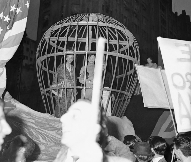 Students and sailors from torpedoed Brazilian ships joined in huge anti-Axis demonstration, which carried out despite driving rainsqualls. Birdcage in which impersonators of Hitler, Mussolini and Hirohito were imprisoned is seen at Rio De Janeiro, Brazil July 4, 1942. (AP Photo)