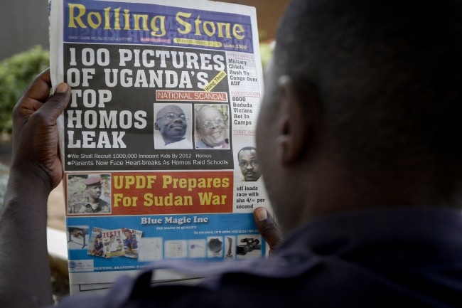 "A Ugandan man reads the headline of the Ugandan newspaper ""Rolling Stone"" in Kampala, Uganda. Tuesday, Oct. 19, 2010, in which the papers reveals the identity of allegedly gay members of Ugandan society and calls for public punishment against those individuals. The ""Rolling Stone"" is a fairly new publication under the management of Giles Muhame, a Ugandan journalist..rights activitists say that at least four homosexuals have been attacked since a Ugandan newspaper published an article this month called ""100 Pictures of Uganda's Top Homos Leak _ Hang Them."" A year after a Ugandan legislator tried to introduce a bill that would have called for the death penalty for being gay, rights activists say homosexuals face a host of hostility. (AP Photo)"