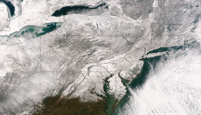 This Friday, January 3, 2014 satellite image provided by the National Oceanic and Atmospheric Administration shows the blanket of snow that stretched from the Midwest across to New England after a massive winter storm moved over the region. (AP Photo/National Oceanic and Atmospheric Administration)