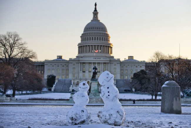 Snowmen sit in front of the Capitol in Washington D.C., on January 3, 2014, after a winter snow storm in the nation's capital. (AP Photo/Evan Vucci)