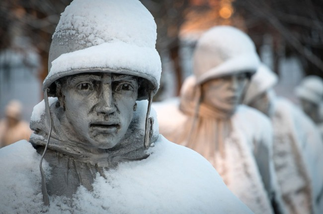 A light dusting of snow from an overnight storm covers the statutes at the Korean War Memorial in Washington D.C., early Friday morning, January 3, 2014. (AP Photo/J. David Ake)