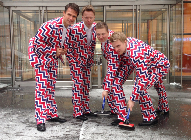 Member of Norway's Men's Olympic Curling Team from left Thomas Ulsrud, Torgor Nergard, Christoffer Svae, and Havard Vad Petersson wear their new Sochi 2014 suits as they pose for a photographer in New York Tuesday Jan. 21, 2014. (AP Photo)