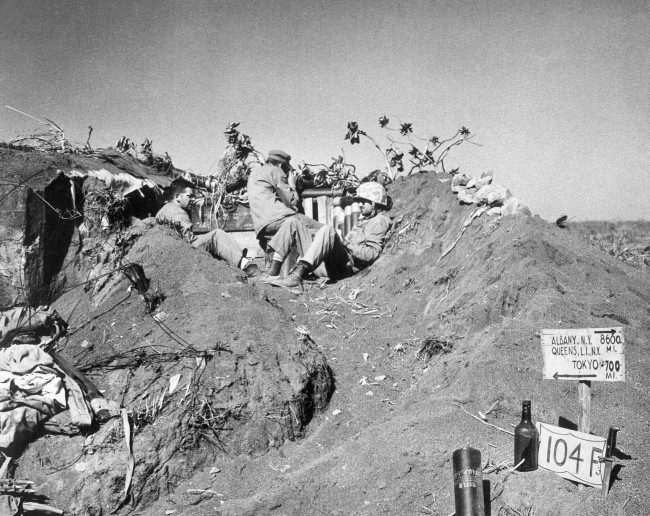 ... dug in Iwo Jima' s coffee grounds sands, Japan on March 16, 1945