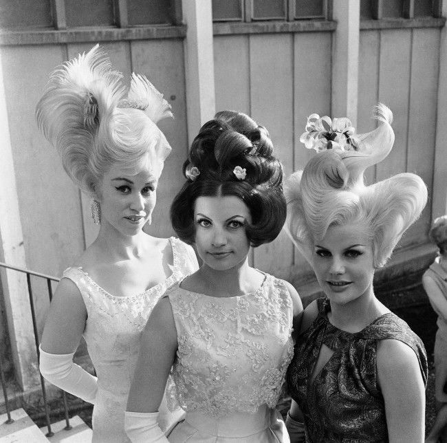 These are the prize winning coiffures in a contest in Munich, Germany on May 1, 1964. They were designed for evening wear and hairdressers said anyone with a little time can copy them.