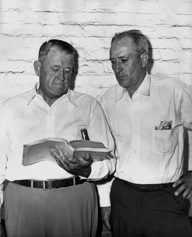 Charles H. Hall, left, of Fort Payne, Ala., and Harmon Hatfield, of Fyfee, Ala., read from the Bible at the Berrien County Courthouse in Nashville, Georgia, Sept. 14, 1961, where Hall is on trial for life in the snake-bite death of Lloyd B. Hill. Hill died after being bitten while handling a rattlesnake during a faith ceremony at the New River Holiness Church in Berrien County in August 1960. Hall was pastor at the time. Hatfield, also charged with murder, is not on trial at this time.