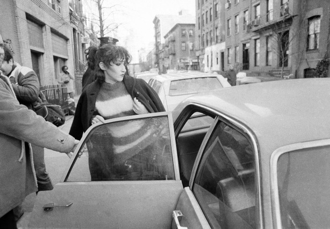 Michelle Robinson leaves her apartment in New York, Feb. 2, 1979 after the body of punk rock star musician Sid Vicious was found in her apartment. Vicious apparently died of an accidental drug overdose. (AP Photo)