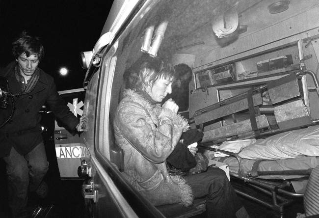 Anne Beverley, mother of the late punk rock star Sid Vicious, sits in ambulance outside the Sixth Precinct police station in New York, Feb. 2, 1979. Police had been questioning her about finding her son's body in an apartment in New York's Greenwich Village section, when she was overcome. She was rushed to a hospital. Police said her son apparently died of a heroin overdose taken the night before at a party given to celebrate his release from prison. He was freed under $50,000 bail, pending trail in the fatal stabbing of his girlfriend Nancy Spungen. (AP Photo/David Karp)