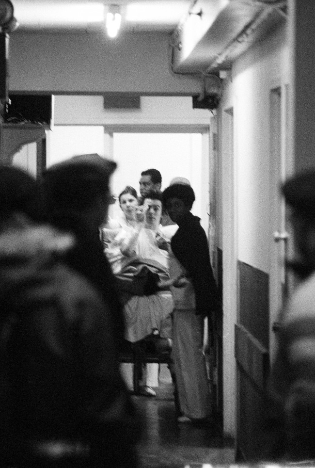 John Ritchie, known as Sid Vicious of the punk rock group the Sex Pistols, is wheeled through the corridor at Jamaica Hospital in Queens, N.Y., Jan. 19, 1978 where he had been taken from a airplane flight which arrived in New York from Los Angeles. A spokesman of the Port Authority of New York and New Jersey, which runs Kennedy Airport, confirmed that an airport doctor diagnosed a drug overdose, but the airport declined to discuss the case on the ground that all cases were confidential. (AP Photo/Ira Schwarz)