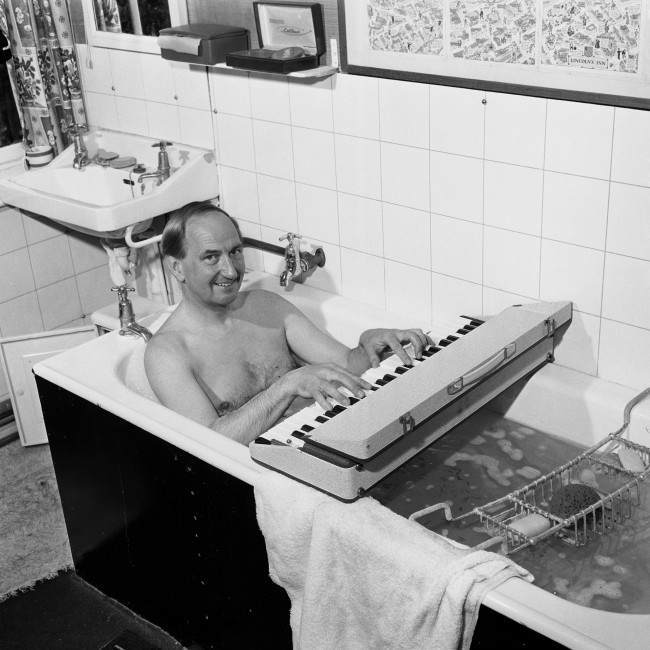 "Concert pianist, Joseph Cooper, who is to play at this years Bath Festival is in constant rehearsal. He is pictured using a dummy key board even while taking a bath at his home in Surrey. Picture date: 11th May 1964. former BBC ""Face The Music"" presenter, Mr Joseph Cooper. The 88-year-old pianist and broadcaster died yesterday morning August 5 2001 at the Nuffield Hospital in Guildford, Surrey, after a short illness, a friend said. He is pictured at his home in Surrey before performing at Bath Festival."