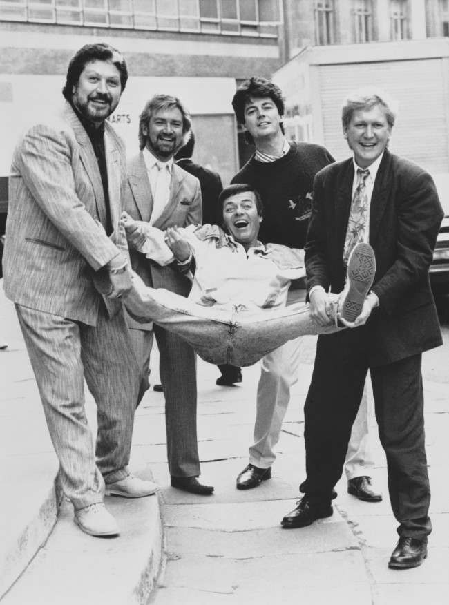 PA 15136731 1 1987 Photo: Mike Smith, Dave Lee Travis, Noel Edmonds And Mike Read Pimp Out Tony Blackburn