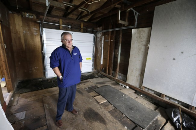 Dann Sears, curator of the Aberdeen Museum of HIstory, stands in the garage of the childhood home of Kurt Cobain