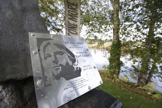 "In this photo taken Monday, Sept. 23, 2013, a sign at ""Kurt Cobain Landing,"" a tiny park blocks from the childhood home of Kurt Cobain, the late frontman of Nirvana, honors him as it overlooks the Wishkah River in Aberdeen, Wash."