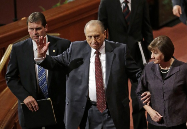 President Thomas S Monson, center, and his daughter, Ann Dibb walk off following the morning session of the 183rd Semiannual General Conference for the Church of Jesus Christ of Latter-day Saints Saturday, Oct. 5, 2013, in Salt Lake City.