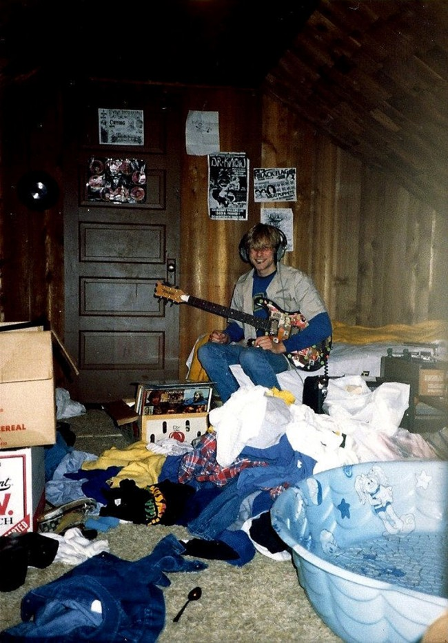 A young Kurt Cobain plays guitar in his childhood home in Aberdeen, Washington, USA. Cobain's mother, Wendy O'Connor, is putting the 1.5-story Aberdeen bungalow, which is assessed at less than $67,000, on the market for $500,000. But she would also be happy entering into a partnership with anyone who wants to turn it into a museum.