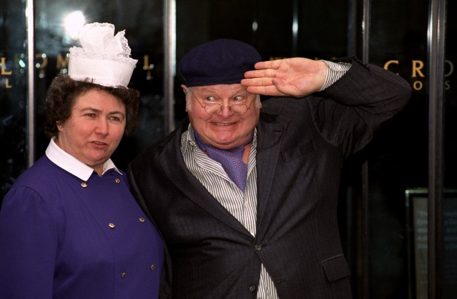 Benny Hill plays his Fred Scuttle character on leaving the Cromwell Hospital in London, 1992. Just 3 months before he died. JOHN STILLWELL/PA Archive/Press Association Images
