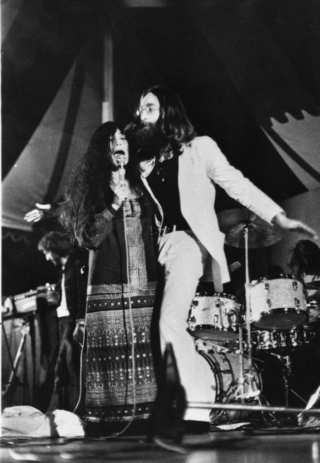 John Lennon and his wife Yoko Ono perform in their first public appearance as the Plastic Ono Band, at Toronto's Varsity Stadium, Sept. 14, 1969.