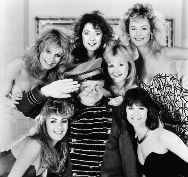 Comedian Benny Hill with his Hill's Angels in 1986: (top, l-r) Selina Caston, Lorraine Doyle, Sue Upton, Natalie Rolls; (bottom, l-r) Zoe Bryant, Liz Jobling.