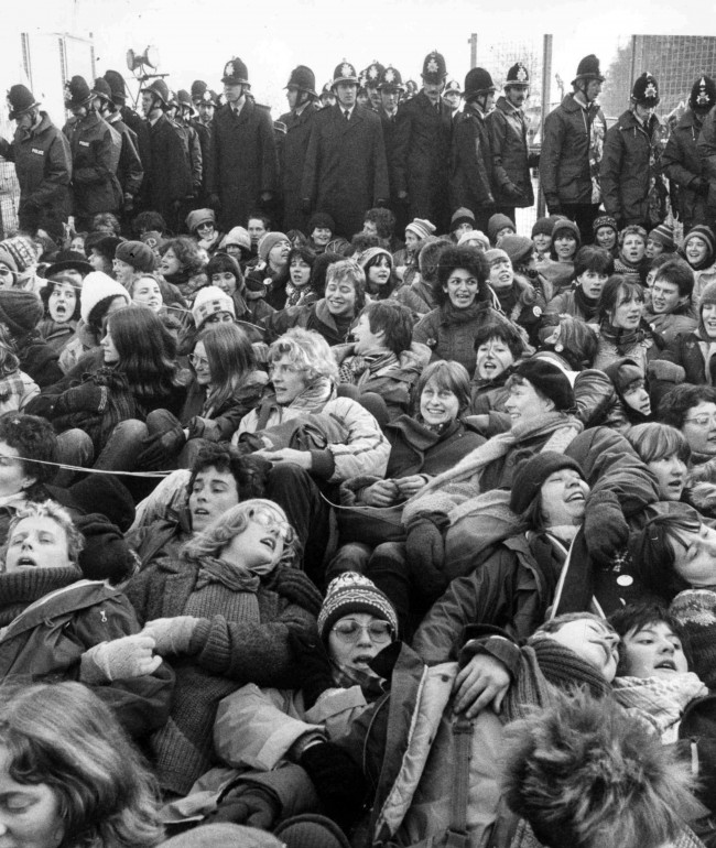 A mass of women protestors block an entrance road to the Greenham Common Air Base, Greenham, on Dec. 13, 1982, in front of a cordon of police, during a demonstration against the siting of nuclear cruise missiles at the base.