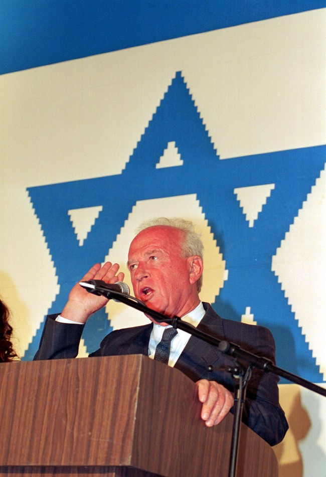 Israeli Prime Minister Yitzhak Rabin gestures as he speaks in Tel Aviv, Israel, Thursday, April 14, 1994. The giant star of David is part of a 4x5.5 meter Israeli flag made from 350,000 plastic Lego bricks which was completed on the occasion of Israel's 46th Independence Day. (AP Photo/Nati Harnik)