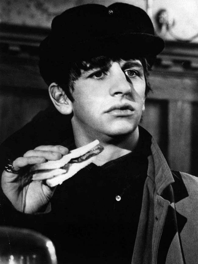 "Drummer Ringo Starr is seen holding a sandwich in a scene from the Beatles' film ""A Hard Day's Night,"" in May 1964."