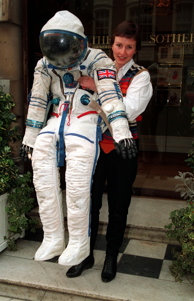 "BRITISH COSMONAUT HELEN SHARMAN WITH THE SUIT SHE WORE DURING PROJECT JUNO, THE 1991 SPACE MISSION. THE SUIT IS ON PUBLIC EXHIBITION AT ""SOTHEBY'S"" BEFORE BEING AUCTIONED IN NEW YORK AS PART OF THE SALE DEDICATED TO ARTEFACTS FROM THE SOVIET SPACE PROGRAMME"