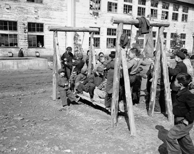Children at the kid''s playground at Maizuru, Japan on March 25, 1953. The first group of repatriates to be returned from Communist China where they had been stranded since the end of World War II completed the formalities through the processing center at Maizuru and were released to go home. The first batch of 2,000 men, women and children came from North China on the Koan Maru