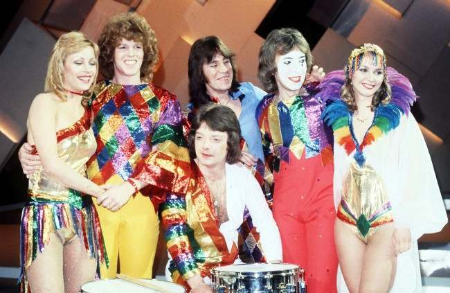 Co-Co, the pop group who will represent Britain in the 1978 Eurovision Song Contest, at the Royal Albert Hall when they won the British heat with the song 'The Bad Old Days'. (l-r) Josie Andrews, Paul Rogers, Terry Bradford, Keith Hasler, Cheryl Baker and, in front, Charles Brennan.