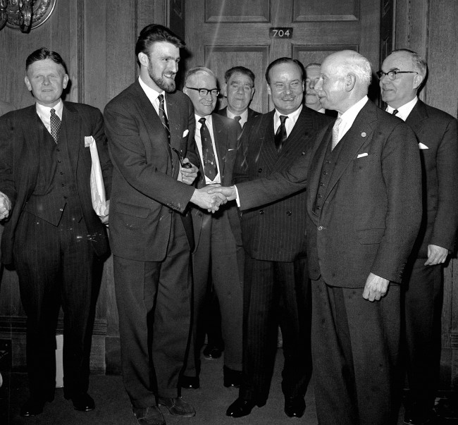 Jimmy Hill (2nd left, beard), Chairman of the Professional Footballers' Association, shakes hands with Joe Richards, President of the Football League, and John Hare (striped suit), at the Ministry of Labour in London. * ...after attending a successful four-and-a-half-hour meeting to discuss football players' conditions and pay. A strike was called off as agreement was reached between the football league and the PFA in the presence of John Hare, Minister of Labour. Date: 18/01/1961