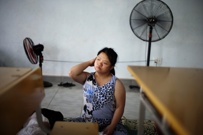 In this photo taken Tuesday Aug. 7, 2012, Le Thi Kim Lien wakes up after noon's nap at a rehabilitation center in Danang, Vietnam. The children were born with physical and mental disabilities that the center's director said were caused by their parents' exposure to the chemical dioxin in the defoliant Agent Orange. Washington was slow to respond, but on Thursday, Aug. 9, 2012 the U.S. for the first time will begin cleaning up leftover dioxin that was stored at the former military base, now part of Danang's airport.
