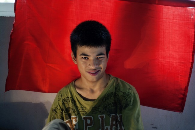 In this photo taken on Aug. 8, 2012, Dang Cong Chinh, 17, smiles at a rehabilitation center in Danang, Vietnam.