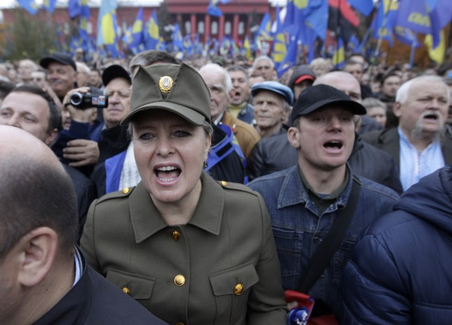 Supporters of the of nationalist Svoboda party (Freedom) shout slogans during a rally marking the 71stanniversary of the Ukrainian Insurgent Army in Kiev, Ukraine, Monday, Oct. 14, 2013. The partisans from the Ukrainian Insurgent Army fought against both Nazis and Red Army soldiers during World War II in a bid to create an independent Ukraine.
