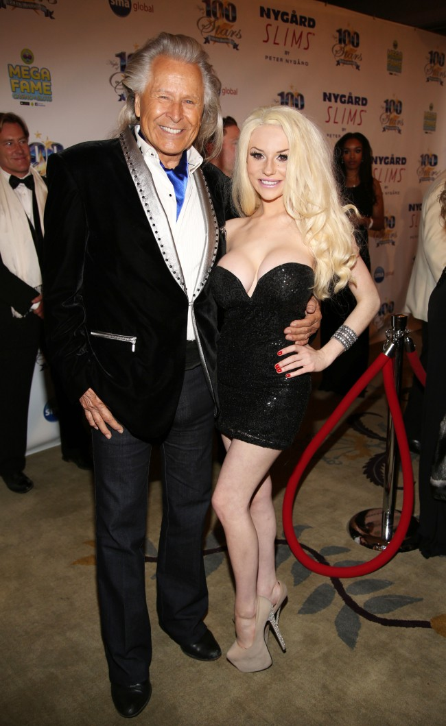 Peter Nygard, left, and Courtney Stodden arrive at the 24th Night of 100 Stars Oscars Viewing Gala at The Beverly Hills Hotel on Sunday, March 2, 2014 in Beverly Hills, Calif.