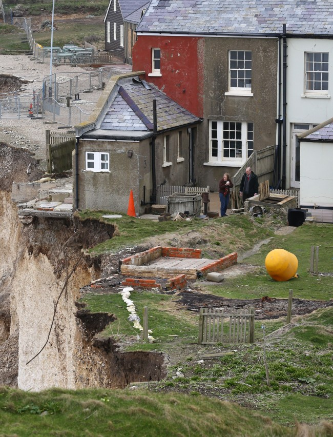 Residents of the cottage on the cliff edge at Birling Gap near Eastbourne, East Sussex, following more recent erosion in the area. Picture date: Friday March 7, 2014.