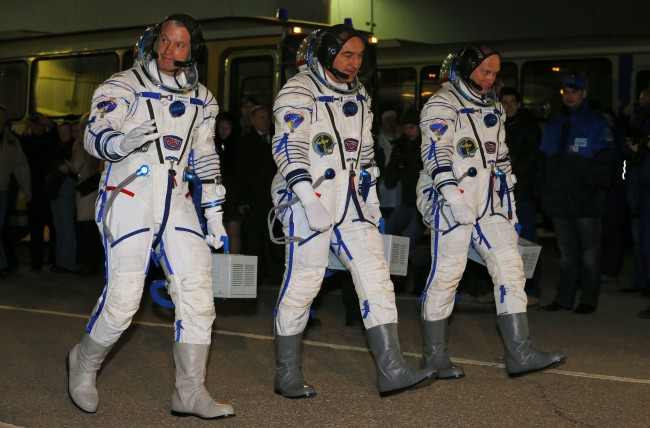 U.S. astronaut Steven Swanson, left, Russian cosmonauts Alexander Skvortsov, center, and Oleg Artemyev, crew members of the mission to the International Space Station (ISS) walk prior the launch of Soyuz-FG rocket at the Russian leased Baikonur cosmodrome, Kazakhstan, Wednesday, March 26, 2014.