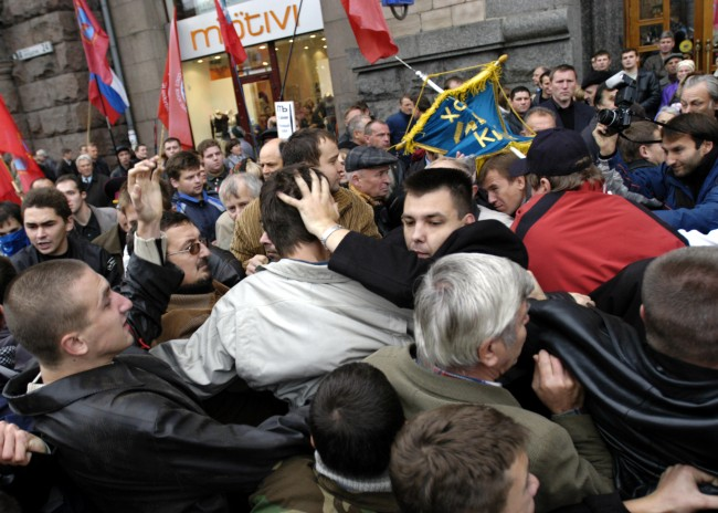 Supporters of Red Army veterans and supporters of Ukrainian partisans clash during a rally in downtown Kiev, Ukraine, Saturday, Oct. 15, 2005. The supporters of the Red Army veterans were rallying to protest against calls by Ukrainian partisans to receive official recognition as World War II veterans. The partisans from the Ukrainian Insurgent Army fought against both Nazis and Red Army soldiers during World War II in a bid to create an independent Ukraine.