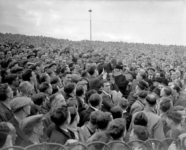 Soccer - Football League Division One - Chelsea v Arsenal - Stamford Bridge A young fan is passed over the heads of the crowd to a better viewing position at the front of the terrace Date: 01/11/1947