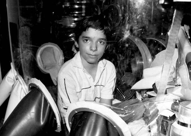 """David Vetter, born with an inherited disorder, which leaves him no natural immunities against disease, is shown in this Sept. 11, 1982 photo in Texas. Now, those closest to Vetter, fear a Walt Disney Studios film about a love-struck boy who crosses the country in a bubble will mock Vetter's life. """"Bubble Boy'' is scheduled to be released on Friday, Aug. 24, 2001, by Touchstone Pictures, a division of Walt Disney Co. In 1984, Vetter died from complications of an experimental bone marrow transplant, thought to be his only chance at survival outside his bubble. (AP Photo)"""